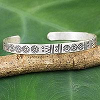 Silver cuff bracelet, 'Ancestral Symbols' - Thailand Karen Hill Tribe Stamped Cuff Bracelet in Silver