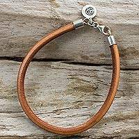 Silver and leather bracelet, 'Serenity Within' - Unisex Tan Leather Bracelet with Om Charm in 950 Silver