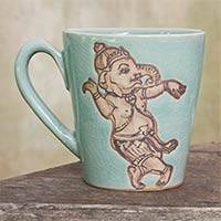 Celadon ceramic mug, 'Whimsical Ganesha' - Light Blue Celadon Ceramic Dancing Ganesha Mug from Thailand