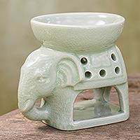 Ceramic oil warmer, 'Sunshine Elephant' - Thailand Ceramic Clay Green Elephant Oil Warmer Hand Crafted