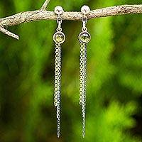 Gold accented peridot dangle earrings,