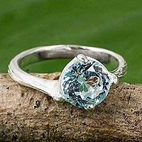 Blue topaz solitaire ring, 'A Singular Melody' - Handcrafted Blue Topaz and Sterling Silver Solitaire Ring