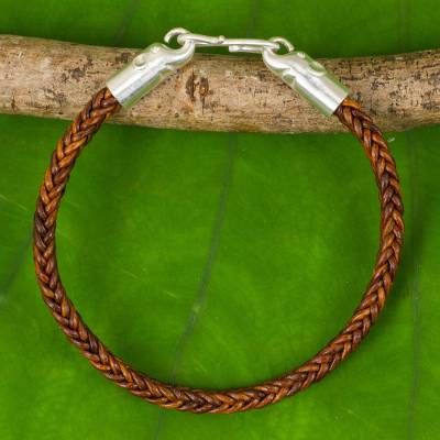 Braided leather bracelet, 'Elephant Promise in Brown' - Hand Crafted Leather Braided Bracelet with Elephant Motif