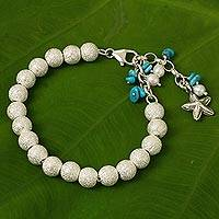 Sterling silver and cultured pearl beaded charm bracelet, 'Sparkling Waves' - Artisan Crafted Silver Bracelet with Starfish Charm