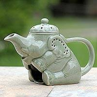 Ceramic oil warmer, 'Adorable Elephant' - Green Ceramic Clay Elephant Oil Warmer from Thailand