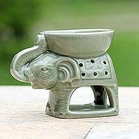 Ceramic oil warmer, 'Welcome Elephant' - Green Ceramic Clay Elephant Oil Warmer from Thailand