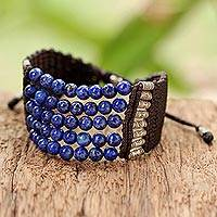 Lapis lazuli beaded bracelet, 'The Deep Sea' - Lapis Lazuli and Silver Thai Beaded Bracelet with Brown Cord