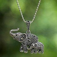 Garnet and marcasite pendant necklace, 'Glistening Elephants' - Garnet and Marcasite Elephant Pendant Necklace from Thailand