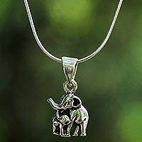 Sterling silver pendant necklace, 'Learning Elephant' - Sterling Silver Elephant Pendant Necklace from Thailand