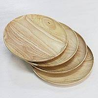 Small wood plates, 'Natural Light Discs' (set of 4) - 4 Artisan Crafted Wood Plates Hand Carved in Thailand