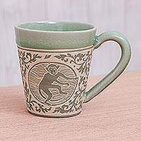 Celadon ceramic mug, 'Thai Zodiac Monkey' - Celadon Glazed Ceramic Mug with Monkey from Thailand