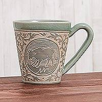 Celadon ceramic mug, 'Thai Zodiac Cow' - Celadon Glazed Ceramic Mug with Cow from Thailand