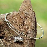 Sterling silver charm bangle bracelet, 'Dimpled Heart' - Sterling Silver Heart Shaped Charm Bracelet from Thailand