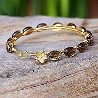 Gold plated smoky quartz bangle bracelet, 'Flower Trellis' - Gold Plated Floral Smoky Quartz Bracelet from Thailand