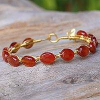 Gold plated carnelian bangle bracelet, 'Flower Trellis' - Carnelian Gold Plated Beaded Bangle Bracelet from Thailand