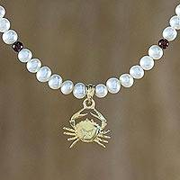 Gold plated cultured pearl and garnet pendant necklace, 'Radiant Cancer' - Gold Plated Cultured Pearl and Garnet Cancer Necklace