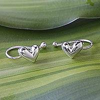 Sterling silver ear cuffs, 'Demure Hearts' - Sterling Silver Heart Ear Cuffs Artisan Crafted in Thailand