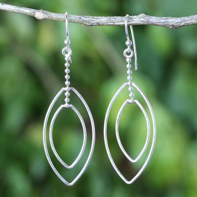 Sterling silver dangle earrings, 'Lotus Symmetry' - Long Sterling Silver Hook Earrings Handcrafted in Thailand