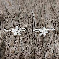 Sterling silver ear cuffs, 'Daisy Shine' - 925 Sterling Silver Floral Ear Cuffs from Thailand