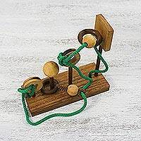 Wood puzzle, 'Basketball' - Handcrafted Wood Puzzle with Balls and Cord from Thailand