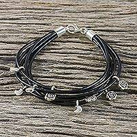 Silver accent leather charm bracelet, 'Black Moons and Roses' - Thai Handmade Moon and Rose Charm Bracelet with Leather Cord