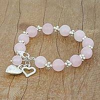 Rose quartz beaded bracelet, 'Soft Hearts' - Rose Quartz Beaded Bracelet with Heart Charms from Thailand