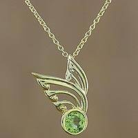 Gold plated peridot pendant necklace, 'Kinnaree Wing' - Gold Plated Peridot Wing Pendant Necklace from Thailand