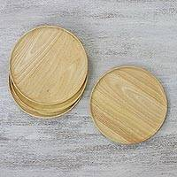Wood plates, 'Circle Delight' (set of 4) - Four Handcrafted Round Rubberwood Plates from Thailand