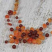 Carnelian beaded statement necklace, 'Carnelian Blossom' - Floral Carnelian Beaded Statement Necklace from Thailand