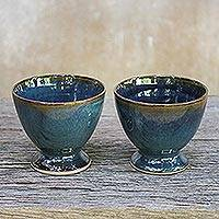 Ceramic teacups, 'Mood Indigo' (pair) - Indigo Blue Footed Ceramic Teacups from Thailand (Pair)