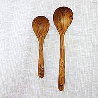 Teakwood serving spoons, 'Love to Cook' (pair) - Pair of Artisan Hand-Carved Teakwood Spoons from Thailand
