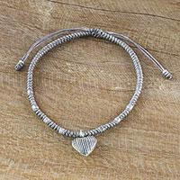 Silver charm cord bracelet,
