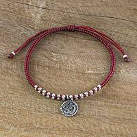 Silver charm bracelet, 'Ancient Om in Red' - Dark Red Cord Bracelet with 950 Silver Om Charm