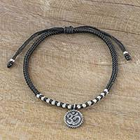 Silver charm bracelet, 'Ancient Om in Black' - Black Cord Bracelet with 950 Silver Om Charm