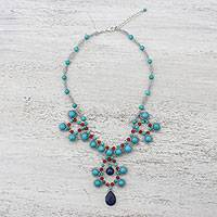 Lapis lazuli and quartz pendant necklace, 'Symmetrical Bubbles in Blue' - Lapis Lazuli and Quartz Beaded Necklace from Thailand