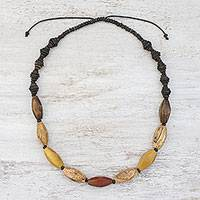 Wood and coconut shell beaded necklace, 'Adventure Lover' - Wood and Coconut Shell Long Necklace from Thailand