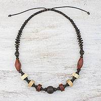 Wood and coconut shell beaded necklace, 'Adventurous Traveler' - Long Assorted Wood Beaded Necklace from Thailand