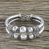 Sterling silver bangle bracelet, 'Gleaming Companions' - Gleaming Sterling Silver Bangle Bracelet from Thailand