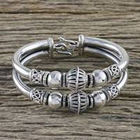 Sterling silver bangle bracelet, 'Majestic Baubles' - Handcrafted Sterling Silver Bangle Bracelet from Thailand
