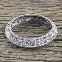 Sterling silver bangle bracelet, 'Spiraling Vines' - Handcrafted Sterling Silver Bangle Bracelet from Thailand