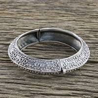 Sterling silver bangle bracelet, 'Dainty Flowers' - Floral Motif Sterling Silver Bangle Bracelet from Thailand