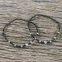 Spinel beaded stretch bracelets, 'Midnight Harmony in Silver' (pair) - Two Spinel and Silver Plated Brass Bracelets from Thailand