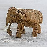Wood statuette, 'Peaceful Elephant' - Handmade Raintree Wood Elephant Statuette from Thailand