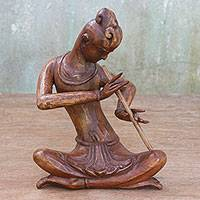 Wood sculpture, 'Thai Flutist in Brown' (10.5 inch) - Wood Sculpture of a Flutist in Brown (10.5 in) from Thailand