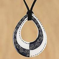 Ceramic pendant necklace, 'Monochrome Magic' - Adjustable Black and White Ceramic Teardrop Pendant Necklace