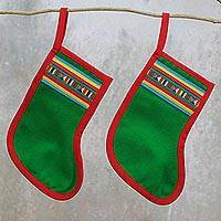 Cotton blend ornaments, 'Lisu Stockings in Green' (pair) - Pair of Cotton Blend Stocking Ornaments from Thailand