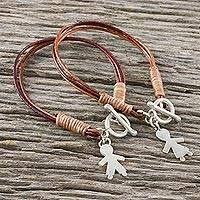 Leather and silver charm bracelets, 'He and She' (pair) - Leather He and She Cord Bracelets with Silver Charms (Pair)