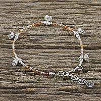 Carnelian beaded bracelet, 'Floral Array' - Carnelian Beaded Bracelet with Silver Flower Charms