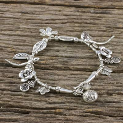 Silver charm bracelet, 'In the Forest' - Handcrafted Karen Silver Charm Bracelet from Thailand