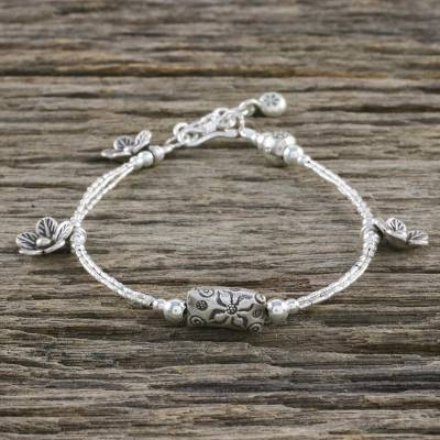 Silver beaded charm bracelet, 'Rise and Shine' - Floral Karen Silver Beaded Charm Bracelet from Thailand